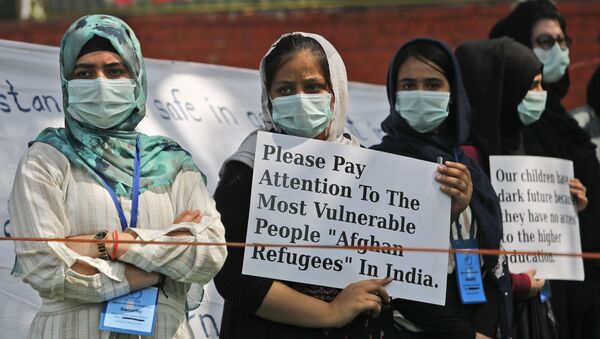 Afghanistan refugee women living in India hold placards during a demonstration to mark International Womens' Day in New Delhi, India, Monday, March 8, 2021.  - Sputnik International