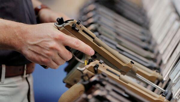 FILE PHOTO: A man inspects a handgun inside of the Beretta booth during the National Rifle Association (NRA) annual meeting in Indianapolis, Indiana - Sputnik International