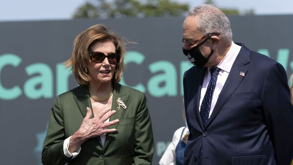 Speaker of the House Nancy Pelosi, D-Calif., speaks with Senate Majority Leader Chuck Schumer, D-N.Y., during Paid Leave for All rally on Capitol Hill in Washington, Wednesday, Aug. 4, 2021. - Sputnik International