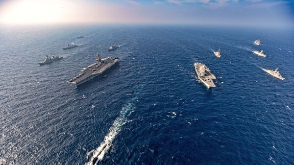 Aircraft carriers and warships participate in the second phase of Malabar naval exercise, a joint exercise comprising of India, US, Japan and Australia, in the Northern Arabian Sea on Tuesday, Nov. 17, 2020. - Sputnik International