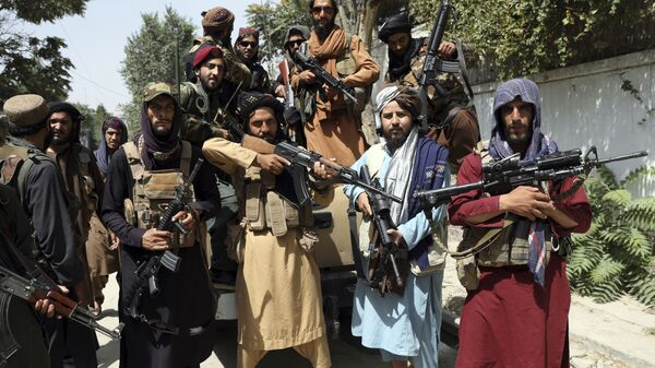 Taliban fighters pose for a photograph in Kabul, Afghanistan, Thursday, Aug. 19, 2021 - Sputnik International