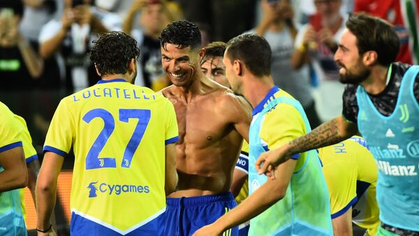 Soccer Football - Italy - Serie A - Udinese v Juventus - Dacia Arena, Udine, Italy - August 22, 2021 Juventus' Cristiano Ronaldo celebrates with teammates after scoring a goal that was later disallowed after a VAR review - Sputnik International