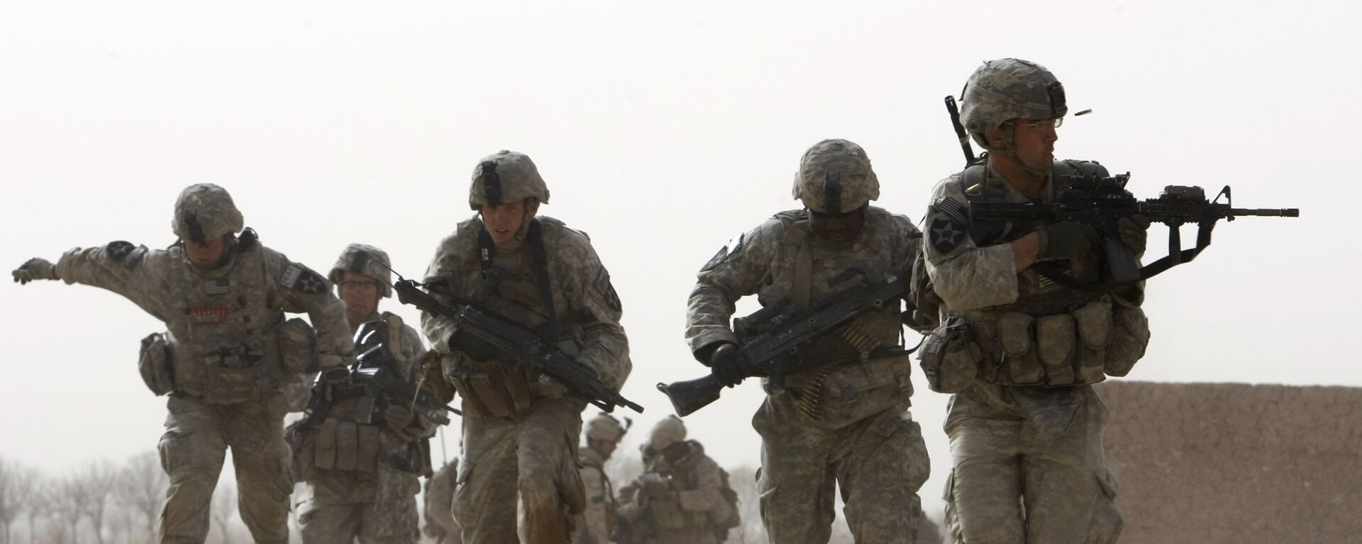 FILE - In this 14 February 2010 file photo, a US soldier returns fire as others run for cover during a firefight with insurgents in the Badula Qulp area, west of Lashkar Gah  in Helmand province, southern Afghanistan - Sputnik International, 1920, 03.09.2021