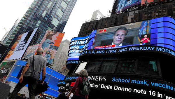 People walk by as a farewell speech by New York Governor Andrew Cuomo is broadcast live on a screen in Times Square on his final day in office in Manhattan, New York City, US, August 23, 2021 - Sputnik International