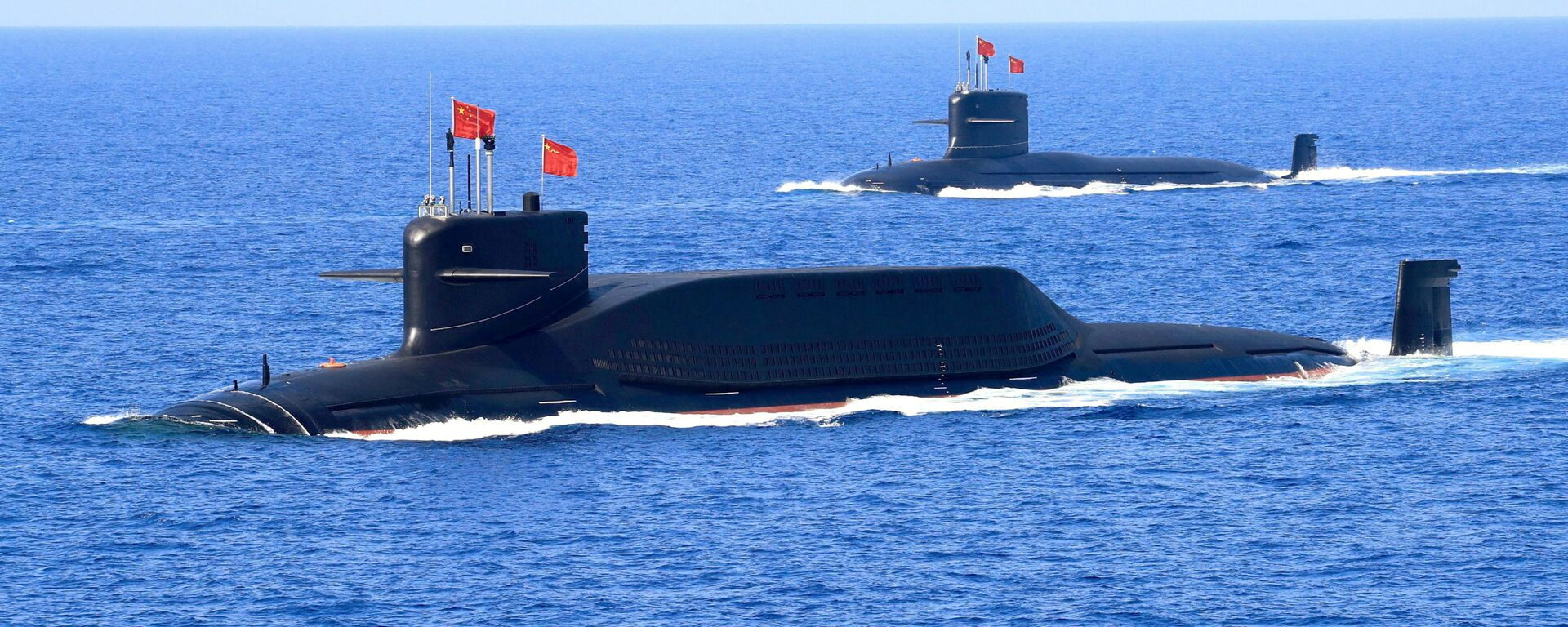 A nuclear-powered Type 094A Jin-class ballistic missile submarine of the Chinese People's Liberation Army (PLA) Navy is seen during a military display in the South China Sea April 12, 2018 - Sputnik International, 1920, 18.09.2021