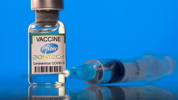 A vial labelled with the Pfizer-BioNTech coronavirus disease (COVID-19) vaccine is seen in this illustration picture taken March 19, 2021 - Sputnik International