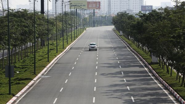 A lone car is seen on an empty highway during lockdown amid the coronavirus disease (COVID-19) pandemic in Ho Chi Minh, Vietnam August 23, 2021.  - Sputnik International