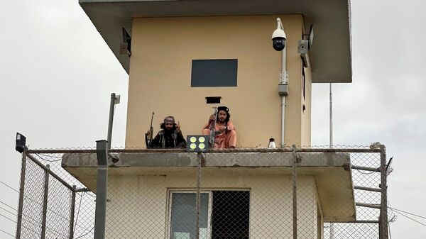 Members of Taliban forces sit at a security tower of the interior ministry in Kabul, Afghanistan August 17, 2021. - Sputnik International