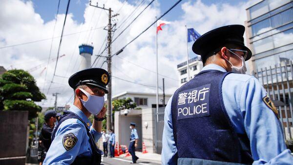 Police officers stand in front of the Polish Embassy, where Belarusian sprinter Krystsina Tsimanouskaya is staying, in Tokyo, Japan August 3, 2021 - Sputnik International