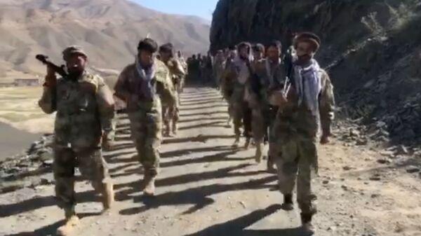Anti-Taliban resistance troops walk in Panjshir Valley, Afghanistan August 25, 2021 in this still image taken from video - Sputnik International