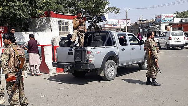 Afghan security forces stand guard at the entrance gate of Hamid Karzai International Airport in Kabul, Afghanistan August 15, 2021.  - Sputnik International