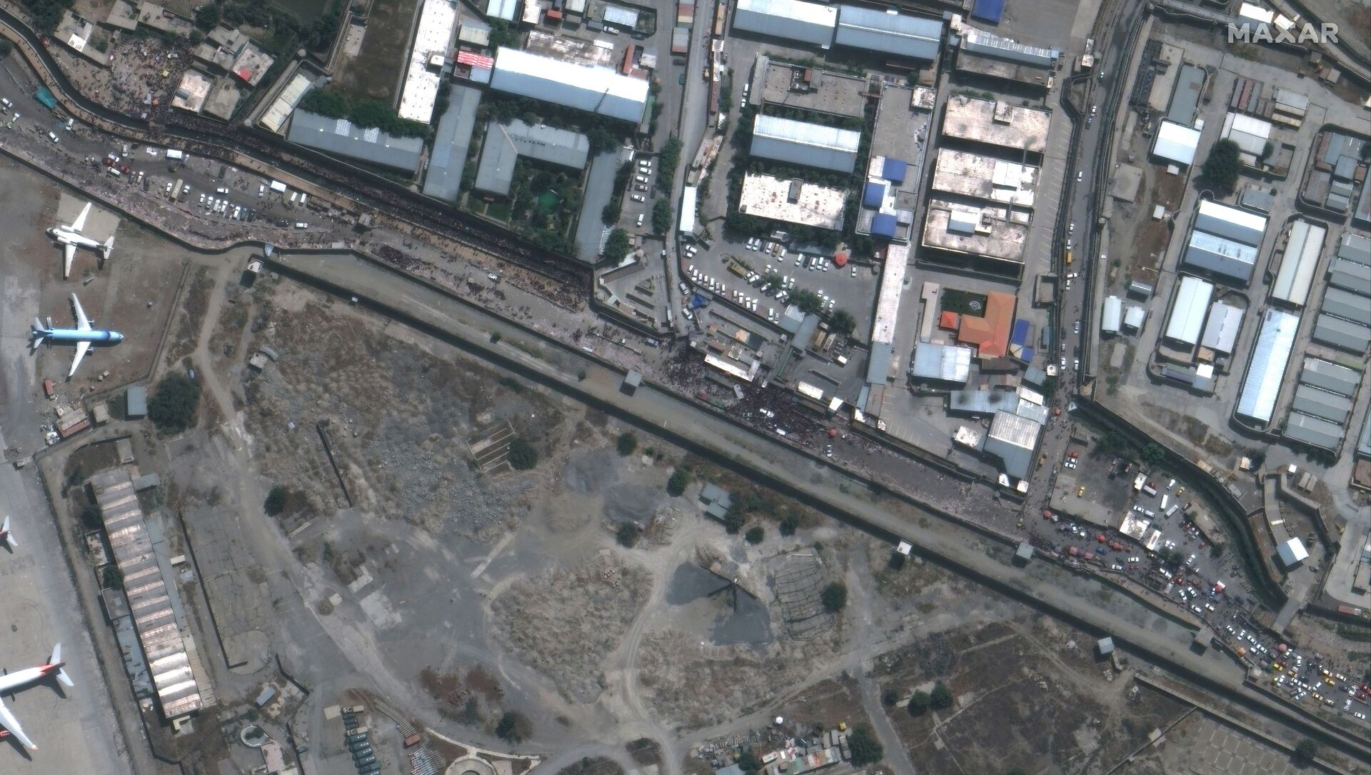 An overview of the Abbey Gate at Hamid Karzai International Airport, in Kabul, Afghanistan August 23, 2021, in this satellite image obtained by Reuters on August 26, 2021. - Sputnik International, 1920, 26.08.2021