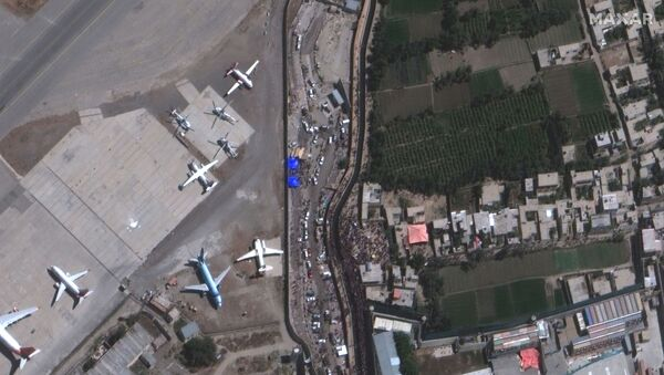 An overview of crowds at the Abbey Gate at Hamid Karzai International Airport, in Kabul, Afghanistan August 24, 2021, in this satellite image obtained by Reuters on August 26, 2021 - Sputnik International