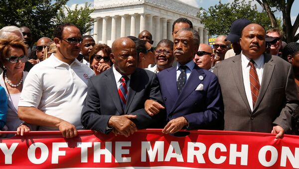 FILE PHOTO: Rev. Al Sharpton (2nd R) links arms with Rep. John Lewis (D-GA) next to Martin Luther King III (R) as they begin to march during the 50th anniversary of the 1963 March on Washington for Jobs and Freedom at the Lincoln Memorial in Washington August 24, 2013.  - Sputnik International