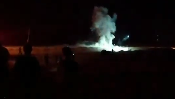 Screenshot from a video allegedly showing an explosion occurring east of Gaza City during night border protests on Saturday - Sputnik International