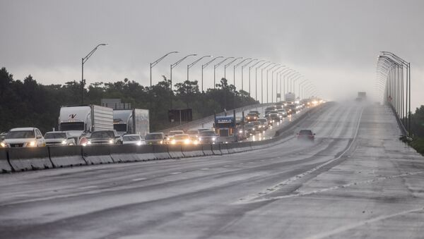 Traffic moves bumper to bumper along I-10 west as residents arrive into Texas from the Louisiana border ahead of Hurricane Ida in Orange, Texas, U.S., August 28, 2021 - Sputnik International