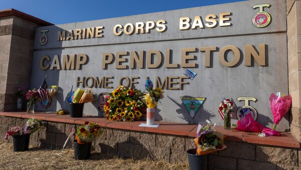 Following the bombing at Hamid Karzai International Airport in Kabul, Afghanistan, flowers are shown placed at the main gate to U.S. Marine Base Camp Pendleton in Oceanside, California, U.S., August 27, 2021. - Sputnik International