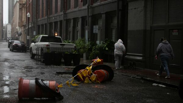 Women walk in the rain as Hurricane Ida makes landfall in Louisiana, in New Orleans, Louisiana, U.S. August 29, 2021. - Sputnik International
