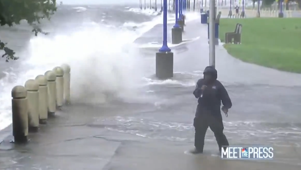 Screenshot from NBC's Meet the Press revealing a reporter struggling to cover the aftermath of Hurricane Ida as he is hit by waves in Louisiana. - Sputnik International