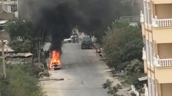A view of remnants of flames from cars where rockets towards Kabul's international airport were fired from but were intercepted by a missile defense system, in Kabul, Afghanistan, August 30, 2021 in this still image taken from video provided on social media - Sputnik International