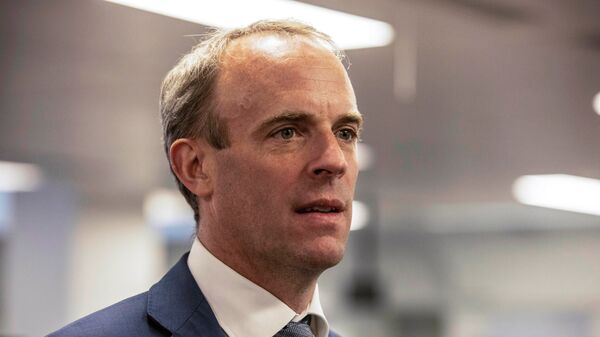 Britain's Foreign Secretary Dominic Raab looks on during a visit of Britain's Prime Minister Boris Johnson at the The Foreign, Commonwealth and Development Office (FCDO) Crisis Centre in London, Britain August 27, 2021 - Sputnik International
