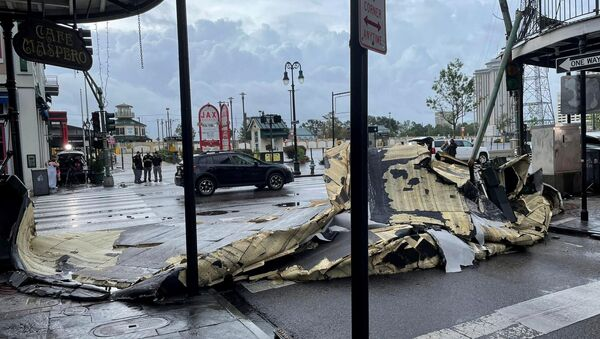 The roof of a building next to Jax Brewery lies on the ground after it was blown off due to strong winds from Hurricane Ida in New Orleans, Louisiana, U.S., August 30, 2021. - Sputnik International