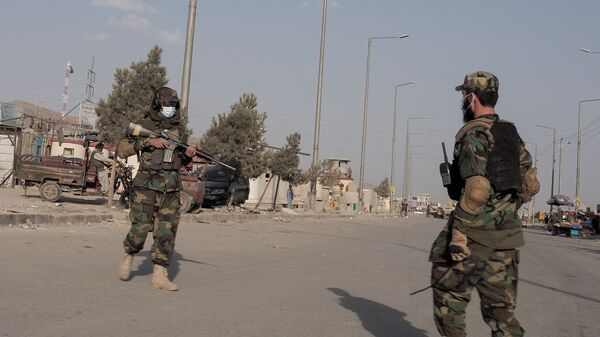 Taliban fighters guard a street leading to the Hamid Karzai International Airport in Kabul, Afghanistan August 29, 2021 - Sputnik International