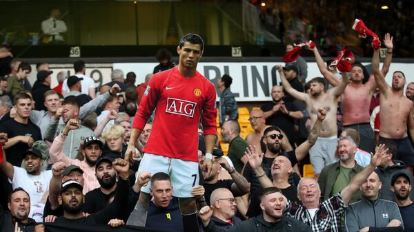 Manchester United fans hold a cutout of Cristiano Ronaldo during the game at Wolves on Sunday 29 August 2021 - Sputnik International