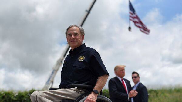 Texas Governor Greg Abbott exits the stage with former U.S. President Donald Trump after a visit to an unfinished section of the wall along the U.S.-Mexico border in Pharr, Texas, U.S. June 30, 2021. - Sputnik International
