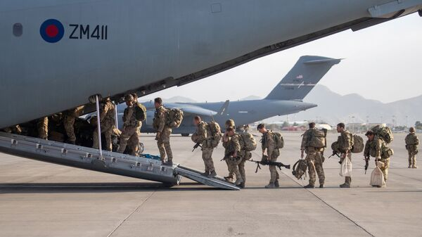 UK military personnel board an A400M aircraft departing Kabul, Afghanistan August 28, 2021 - Sputnik International