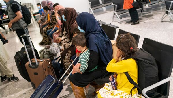 Refugees from Afghanistan wait to be processed after arriving on an evacuation flight at Heathrow Airport, in London, Britain August 26, 2021 - Sputnik International