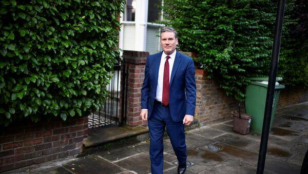 Britain's Labour Party leader Keir Starmer leaves his home in London - Sputnik International