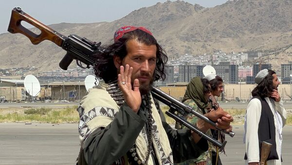 Taliban forces patrol at a runway a day after U.S troops withdrawal from Hamid Karzai International Airport in Kabul, Afghanistan August 31, 2021 - Sputnik International
