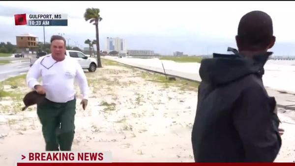 A screenshot from TV coverage showing Dagley running toward MSNBC reporter Shaquille Brewster on August 30, 2021 - Sputnik International