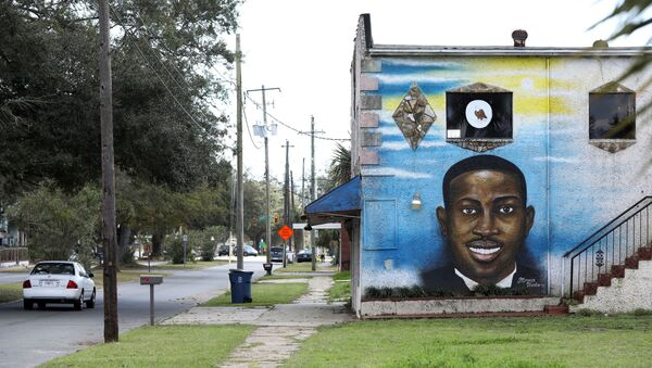 A mural depicts shot Black man Ahmaud Arbery as a Black History Month Memorial Ride is held in memory of those who have died through race-related violence, in Brunswick, Georgia, U.S., February 27, 2021. - Sputnik International