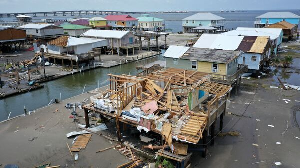 Homes destroyed in the wake of Hurricane Ida are shown September 2, 2021 in Grand Isle, Louisiana. Ida made landfall August 29 as a Category 4 storm near Grand Isle, southwest of New Orleans, causing widespread power outages, flooding and massive damage.   - Sputnik International
