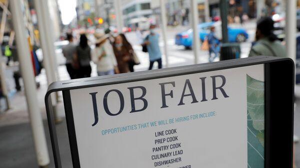 Signage for a job fair is seen on 5th Avenue after the release of the jobs report in Manhattan, New York City, U.S., September 3, 2021.  - Sputnik International