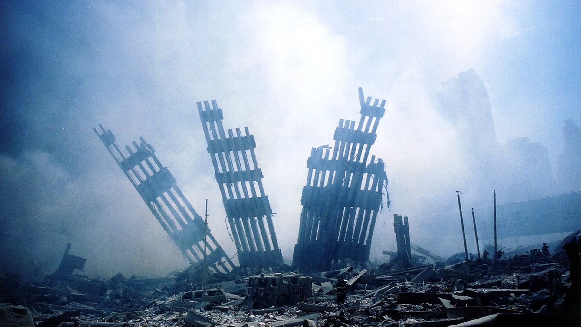 In this file photo the rubble of the twin towers of the World Trade Center smoulder following a terrorist attack in lower Manhattan, New York on September 11, 2001. - Sputnik International, 1920, 05.09.2021