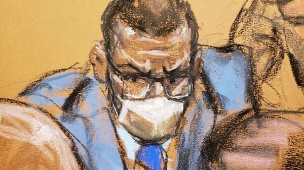 R. Kelly confers with his lawyers during his sex abuse trial at Brooklyn's Federal District Court in a courtroom sketch in New York, 2 September 2021 - Sputnik International