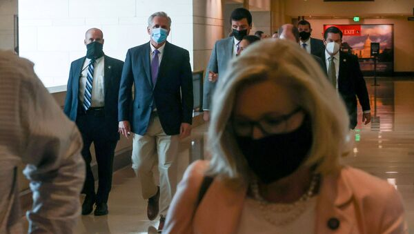 U.S. House Minority Leader Kevin McCarthy (R-CA) speaks with a reporter as he and fellow House members including Representative Liz Cheney (R-WY) depart a Biden administration briefing on Afghanistan at the U.S. Capitol in Washington, D.C., U.S. August 24, 2021 - Sputnik International