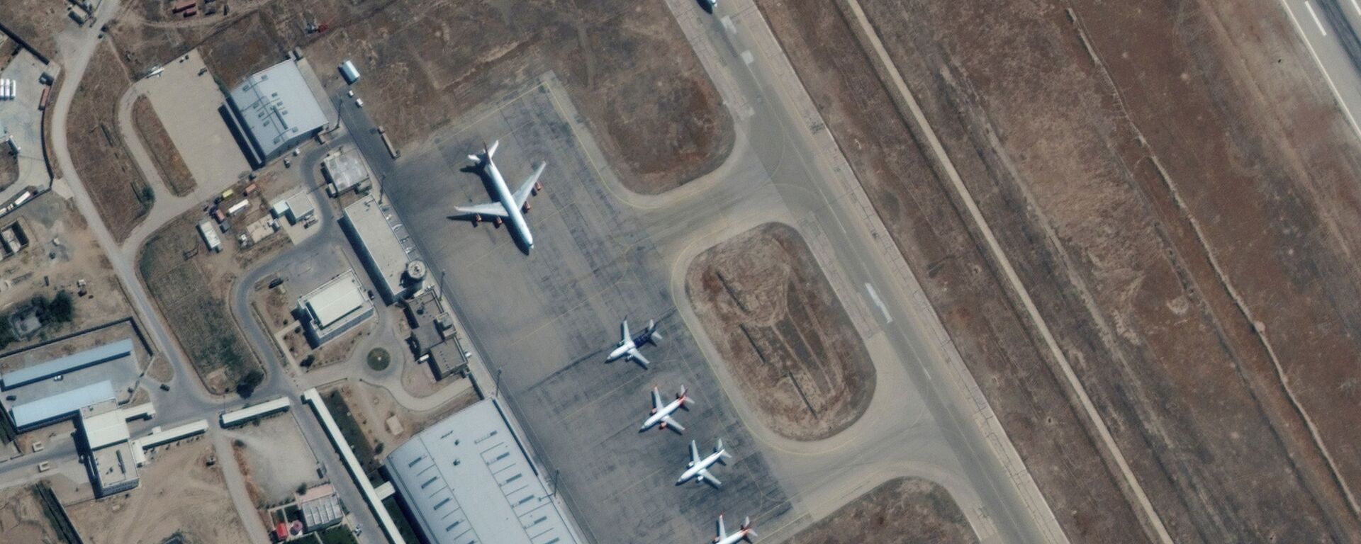 Six commercial airplanes are seen near the main terminal of the Mazar-i-Sharif airport, in northern Afghanistan, September 3 2021. Picture taken September 3, 2021. - Sputnik International, 1920, 05.09.2021
