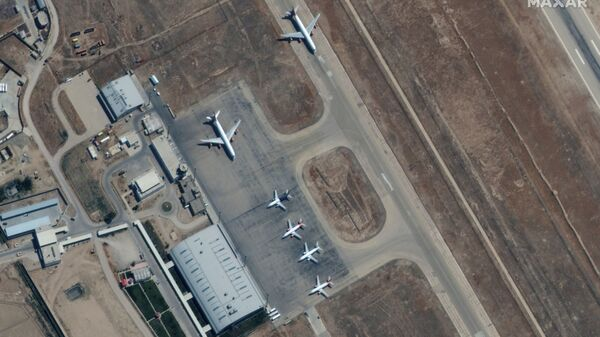Six commercial airplanes are seen near the main terminal of the Mazar-i-Sharif airport, in northern Afghanistan, September 3 2021. Picture taken September 3, 2021. - Sputnik International