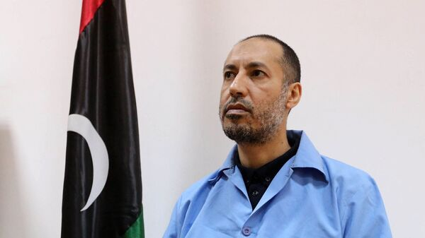 Saadi Kadhafi, the son of slain Libyan dictator Moamer Kadhafi, sits dressed in prison blues waiting before trial in a courthouse in the Libyan capital Tripoli on March 13, 2016 - Sputnik International