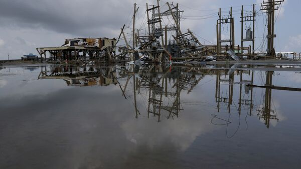 Damaged power lines and homes can be seen days after hurricane Ida ripped through Grand Isle, Louisiana, U.S., September 2, 2021. - Sputnik International
