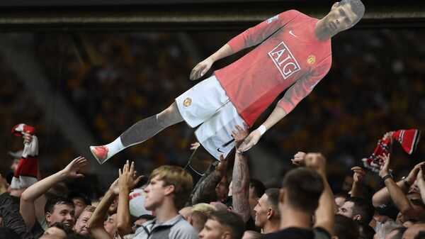 Soccer Football - Premier League - Wolverhampton Wanderers v Manchester United - Molineux Stadium, Wolverhampton, Britain - August 29, 2021 General view of Manchester United fans holding up a cardboard cut out of Cristiano Ronaldo - Sputnik International