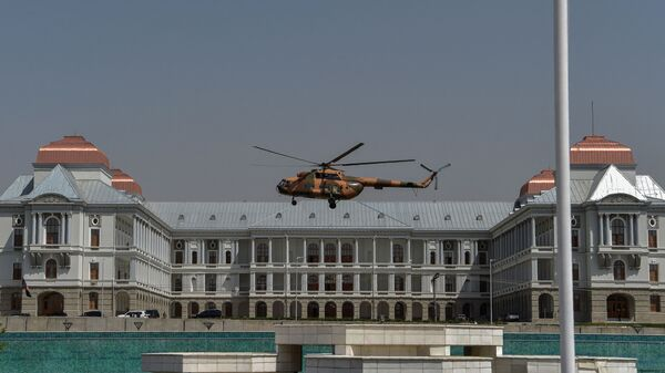 An Afghan Air Force's helicopter rovers near the Afghan Parliament house in Kabul on August 2, 2021. - Sputnik International
