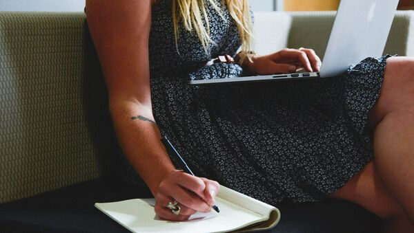 Woman copies something from her laptop - Sputnik International