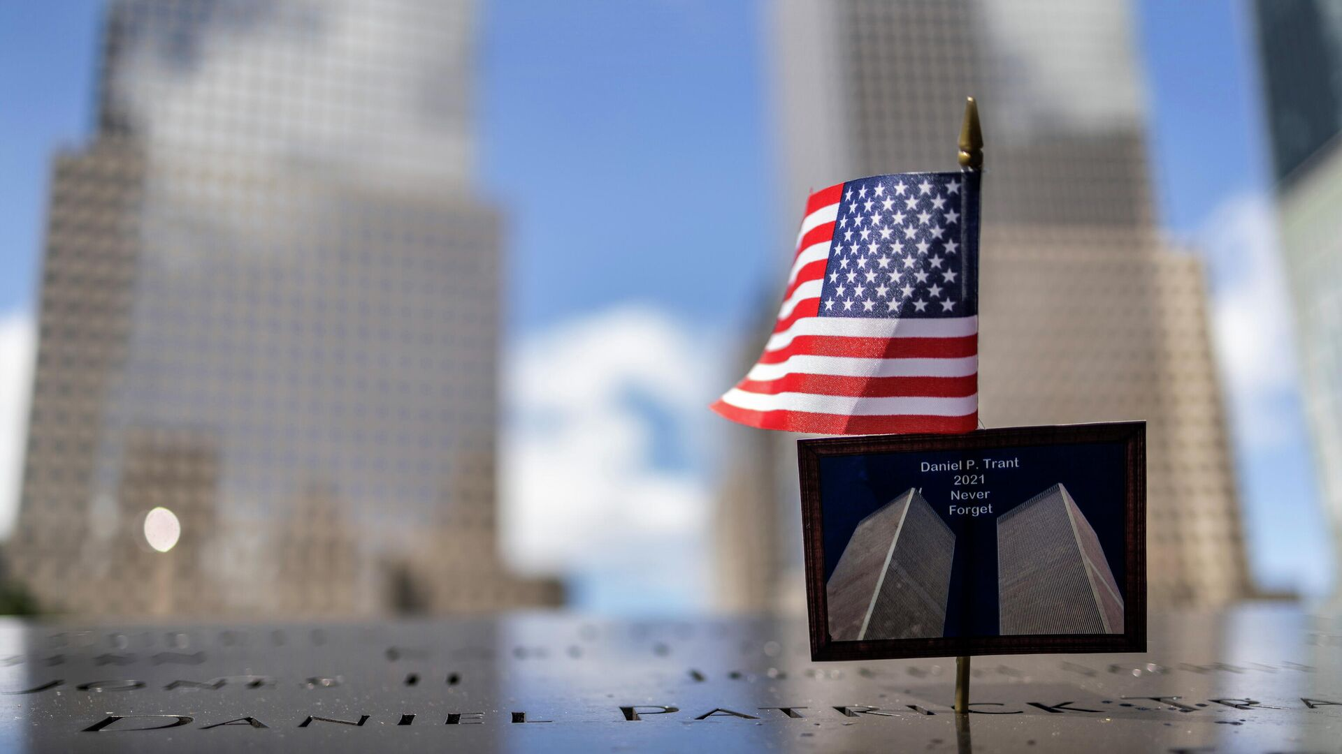 A postcard of the Twin Towers is seen at the 9/11 Memorial ahead of the 20th anniversary of the September 11 attacks in Manhattan, New York City, U.S., September 10, 2021. - Sputnik International, 1920, 11.09.2021