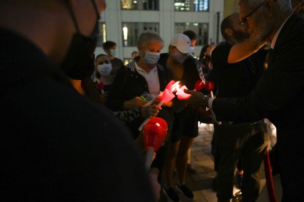 People light candles during a 9/11 commemoration ceremony at the Greek Orthodox St. Nicholas National Shrine adjacent to the 9/11 Memorial & Museum in New York City on 10 September 2021. - Sputnik International