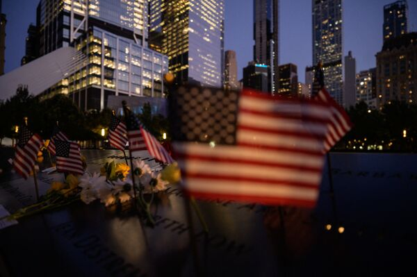 US flags are displayed before a reflecting pool at the 9/11 memorial commemorating the 2001 terrorist attacks, in New York on 10 September 2021. - Sputnik International